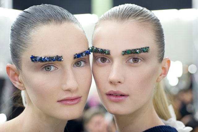 Chanel's Fall 2012 eyebrow embellishments. Photo by: Vincent Lappartient, courtesy of Chanel